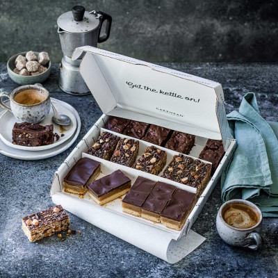 image of cake box delivery of gluten and vegan brownies and caramel shortbread