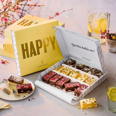 image of selection box delivery of white chocolate brownie, raspberry chocolate brownie and caramel shortbread