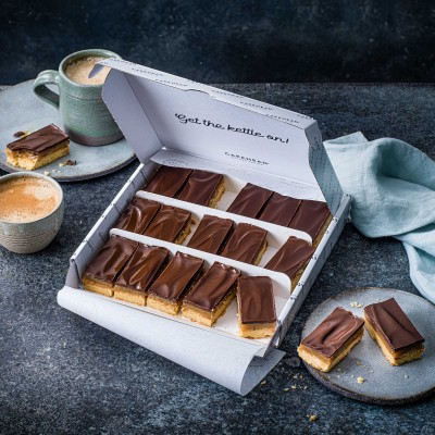 image of cake box delivery of vegan and gluten free caramel shortbread